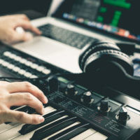 Music producer is recording sound on Computer