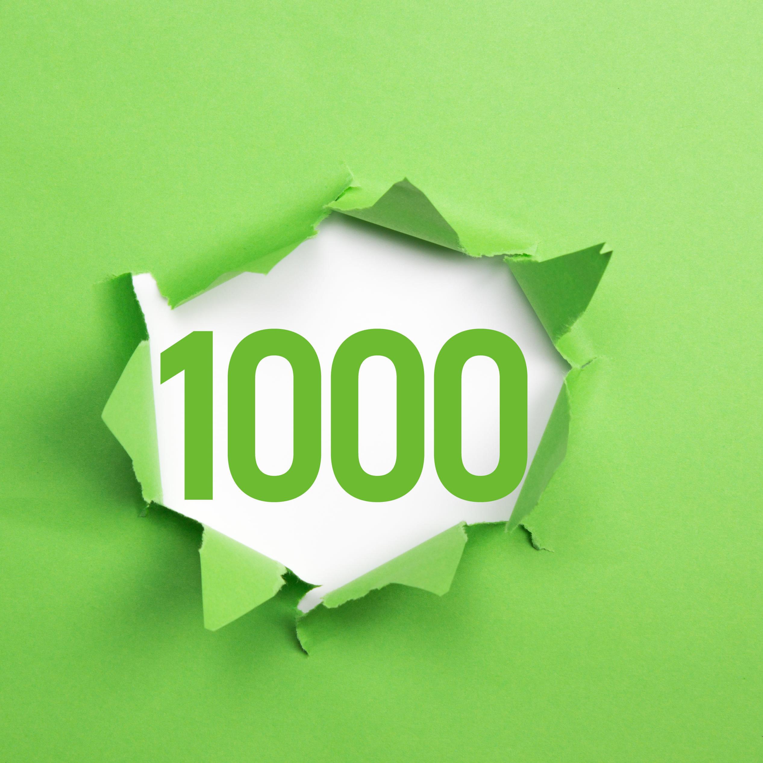 grüne Nummer 1000 auf grünem Papier
